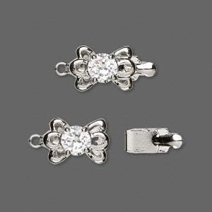 Rhodiumplated slotje, 13x9mm, strik met zirconia steen